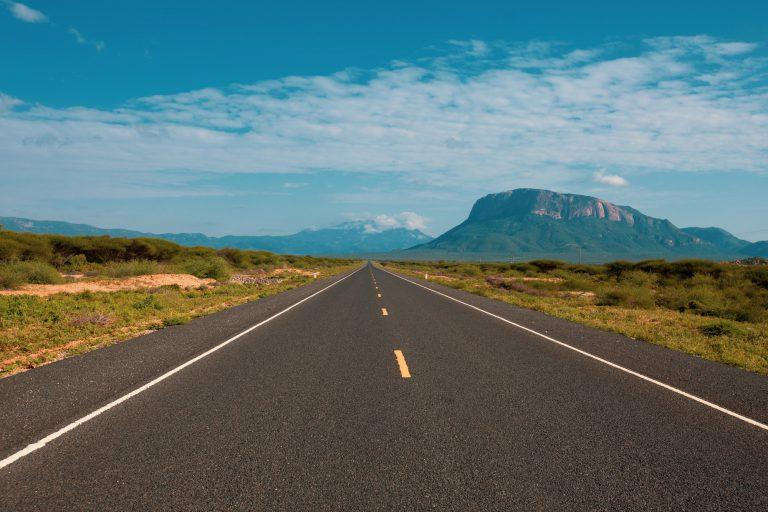 african landscape along the tarmac road, nairobi, kenya